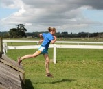 Jaz over the horse jumps.